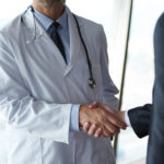 doctor businessman shaking hands